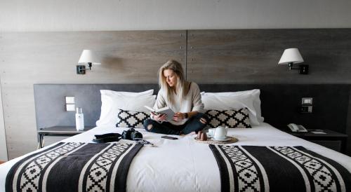 Cama o camas de una habitación en Río Serrano Hotel + Spa