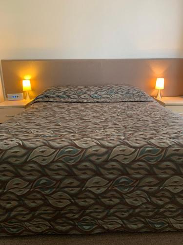 A bed or beds in a room at Shellharbour Resort and Conference Centre