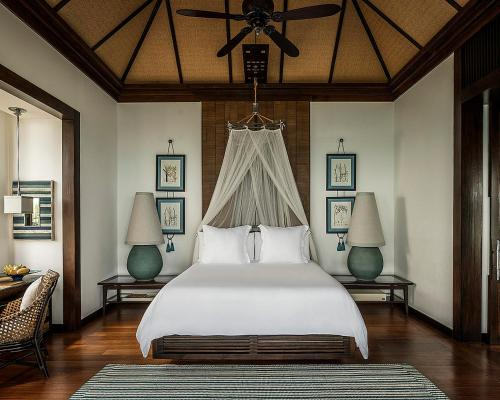A bed or beds in a room at Four Seasons Resort Koh Samui