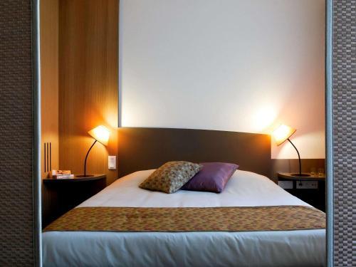 Ein Bett oder Betten in einem Zimmer der Unterkunft Aparthotel Adagio Bordeaux Centre Gambetta