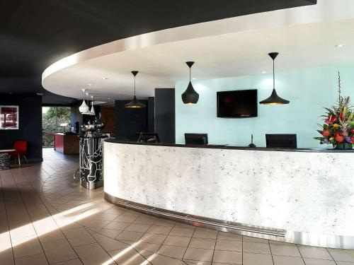 The lobby or reception area at ibis Swansea