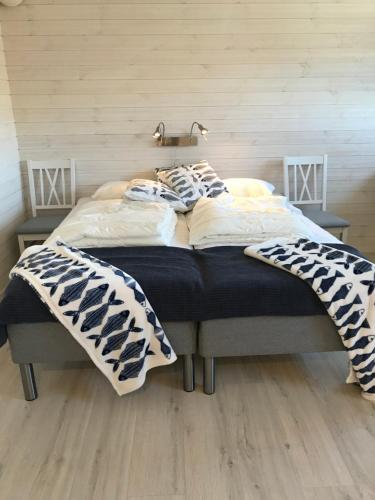 Säng eller sängar i ett rum på Sjöboa Björkö - Sea Lodge