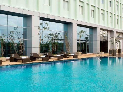 The swimming pool at or near Novotel Bangka Hotel & Convention Center
