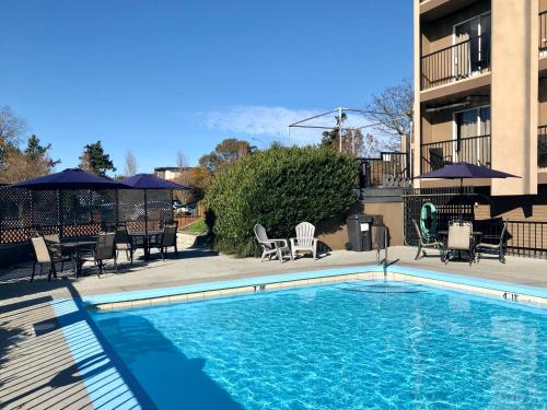 The swimming pool at or near Travelodge by Wyndham Victoria