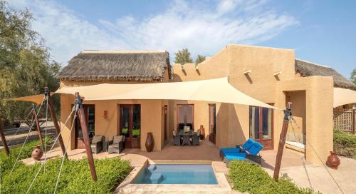The swimming pool at or near Anantara Sir Bani Yas Island Al Sahel Villas