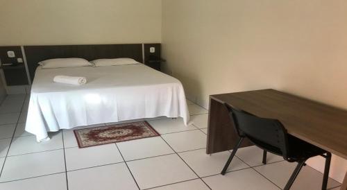 Cama ou camas em um quarto em Hotel Tropical Garden