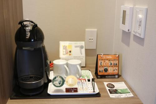 Coffee and tea-making facilities at PORTA INN bentencho
