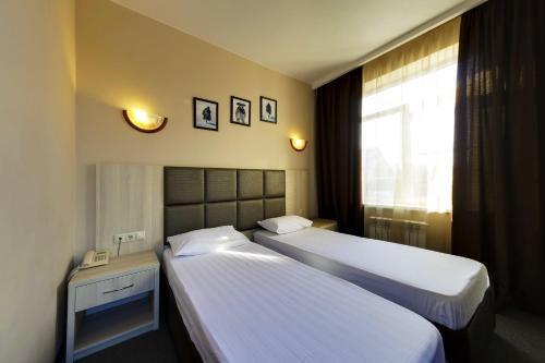 A bed or beds in a room at Hotel Marton Sholokhova