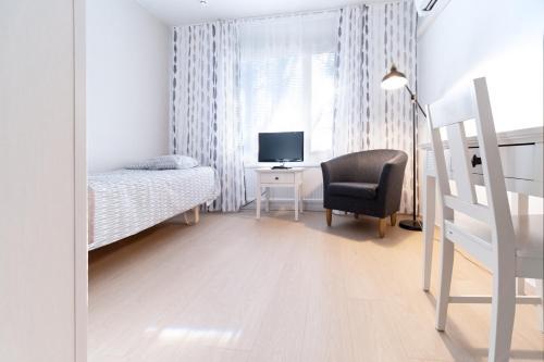 TV tai viihdekeskus majoituspaikassa Motelli Marjaana