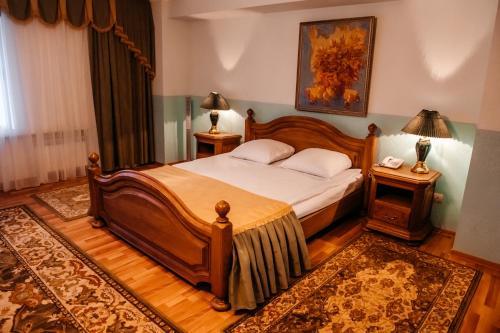 Кровать или кровати в номере ГРК Державинская