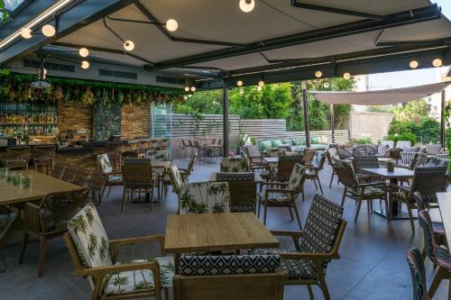 Εστιατόριο ή άλλο μέρος για φαγητό στο Palmyra Beach Hotel