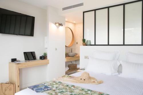 Un ou plusieurs lits dans un hébergement de l'établissement Le Lodge des Îles d'Or
