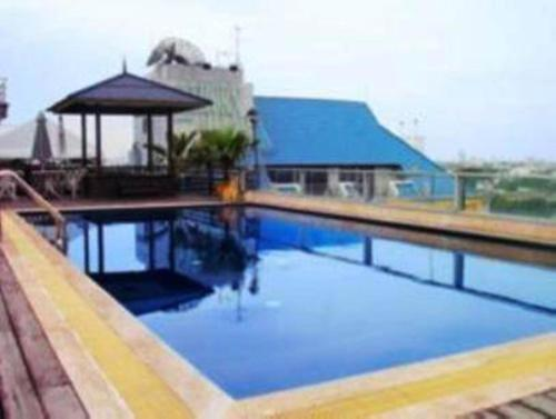 The swimming pool at or near King Royal Garden Inn