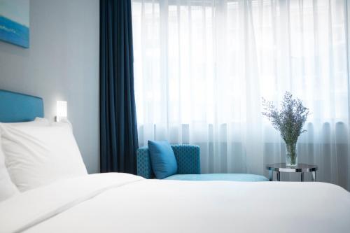 Holiday Inn Express - Xiamen City Center, an IHG Hotelにあるベッド