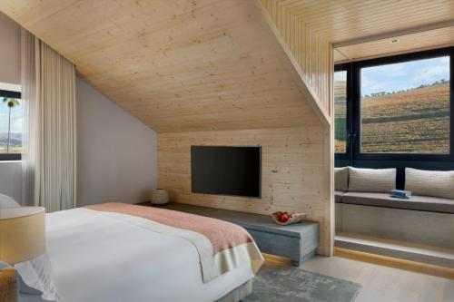 A bed or beds in a room at Six Senses Douro Valley