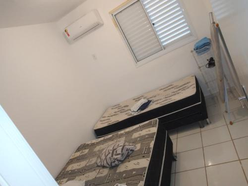 A bed or beds in a room at Residencial Montreal