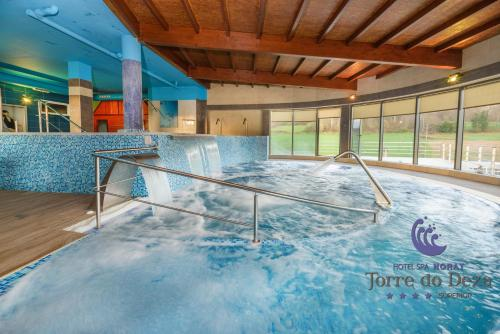 The swimming pool at or near Hotel Spa Norat Torre Do Deza 4* Superior