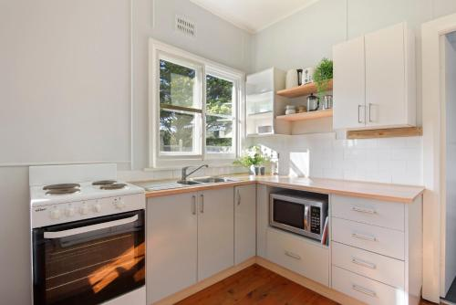 A kitchen or kitchenette at Calm Waters Waterfront Cottages