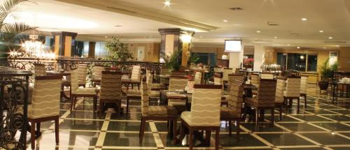 A restaurant or other place to eat at Aston Tropicana Hotel Bandung