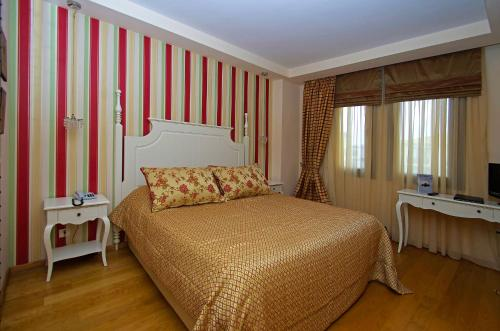 A bed or beds in a room at Mediterranean Village Hotel & Spa