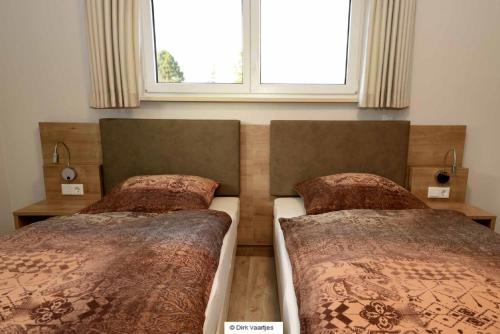 A bed or beds in a room at Landgasthof Vogt
