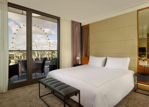A bed or beds in a room at Park Plaza County Hall London