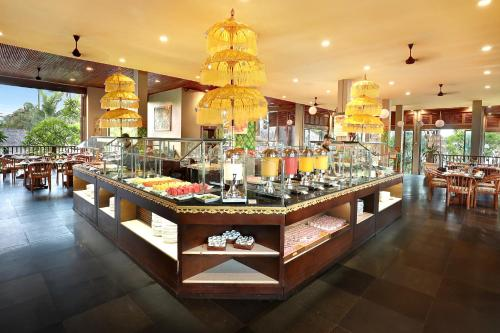 A restaurant or other place to eat at Legian Beach Hotel