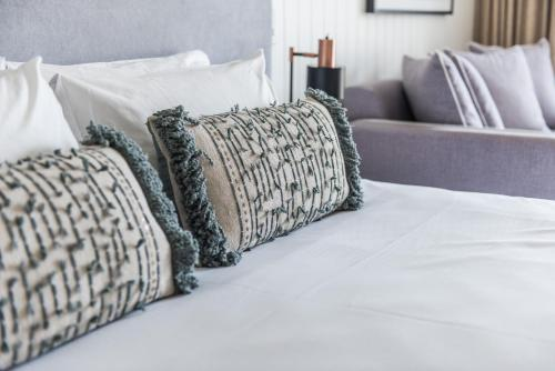 A bed or beds in a room at Waves Byron Bay