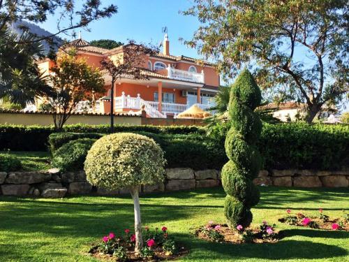 A garden outside Villa Paradise