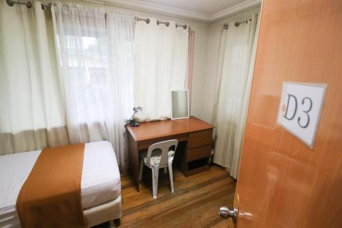 A bed or beds in a room at Guesthouse Storyshare Guadalupe