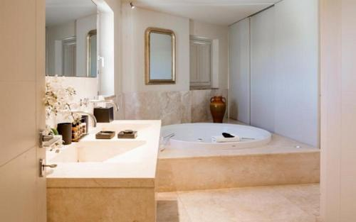 A bathroom at Castello di Velona - The Leading Hotels of the World