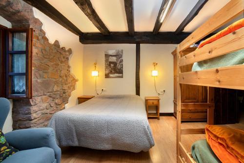 A bunk bed or bunk beds in a room at Posada Elbete