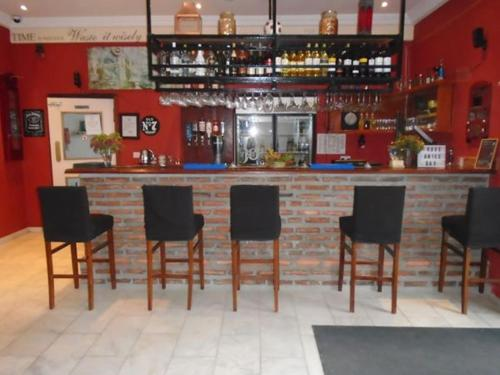 The lounge or bar area at Ocean Villa Heights