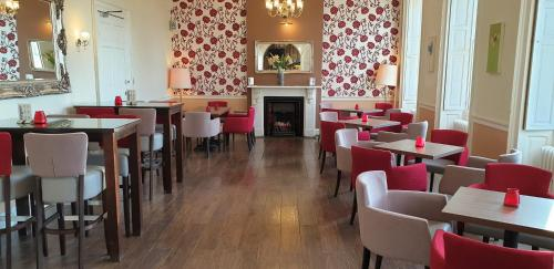 A restaurant or other place to eat at Haughton Hall