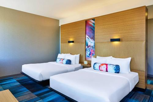 A bed or beds in a room at Aloft Broomfield Denver