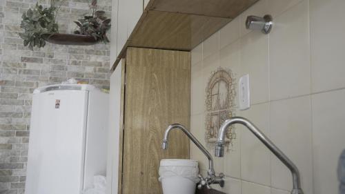 Um banheiro em Casa Itaguá