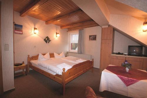 Ein Bett oder Betten in einem Zimmer der Unterkunft Pension Barbara