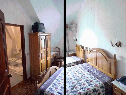 A bed or beds in a room at Residencial Sra. da Lomba