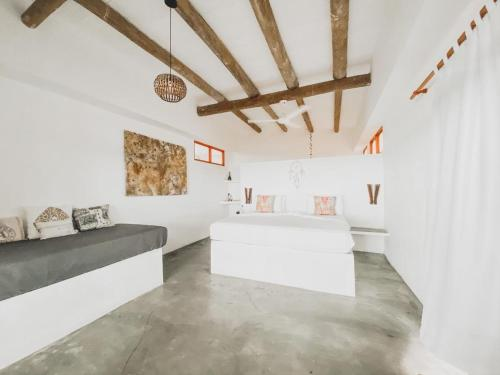 A bed or beds in a room at Casa Coraje