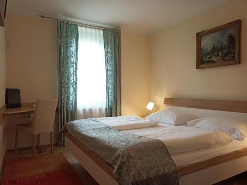 A bed or beds in a room at Adlerhof