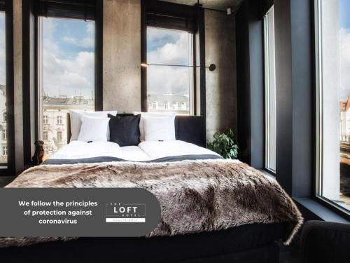 A bed or beds in a room at The Loft All-Inclusive Hotel Adults Only
