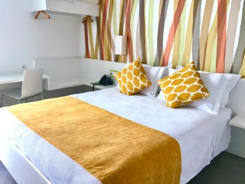 Uma cama ou camas num quarto em Hotel 3K Faro Aeroporto
