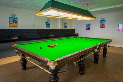 A pool table at Barrowfield Hotel