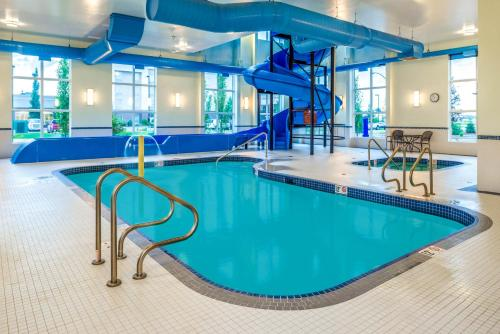 The swimming pool at or near Microtel Inn & Suites by Wyndham Red Deer