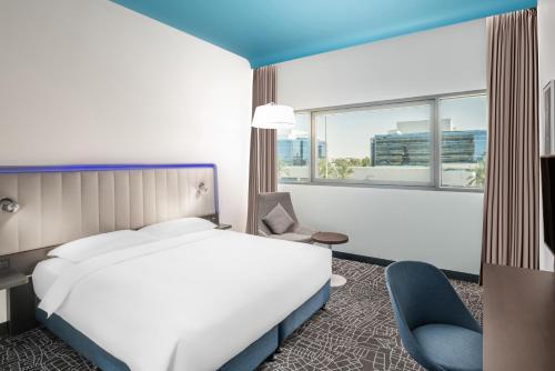 Cama ou camas em um quarto em Park Inn by Radisson, Riyadh