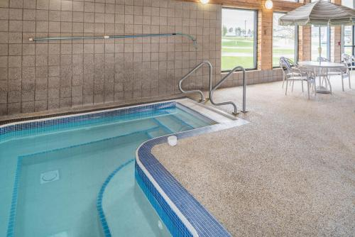 The swimming pool at or near AmericInn by Wyndham Valley City Conference Center
