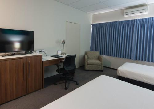 A television and/or entertainment center at Ocean Centre Hotel