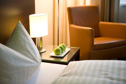 A bed or beds in a room at Flemings Conference Hotel Wien
