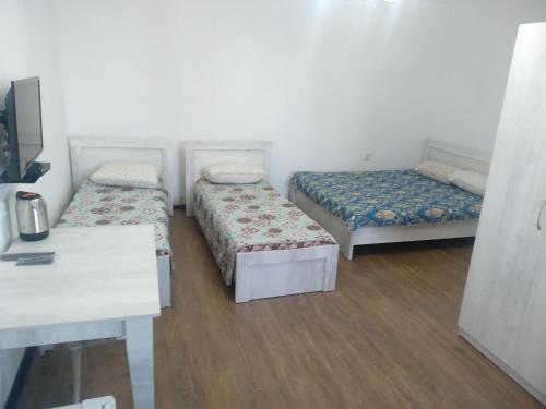 Кровать или кровати в номере Hotel Alazis Alakol