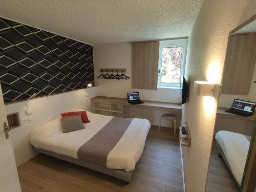 A bed or beds in a room at Best Hôtel Euromédecine
